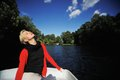Girl floats on a boat and enjoy nature Royalty Free Stock Photo