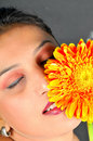 Girl and flower Stock Photos