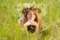 Girl  in flower chaplet Royalty Free Stock Photo