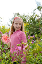 Girl in the flower garden Stock Photo