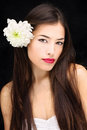 Girl with flower in her hair pretty long Stock Image