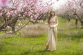The girl in the flowered garden Royalty Free Stock Photo
