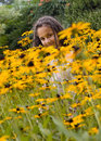 Girl and flowers. Royalty Free Stock Photography
