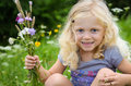Girl with flowers blond in her hand Royalty Free Stock Photos