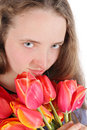 Girl with flowers the a bouquet of Royalty Free Stock Photography