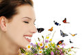 Girl with flowers and butterflies Stock Photo
