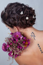 Girl with flowers and tattoo Royalty Free Stock Photos