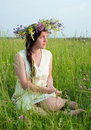 Girl in flowers wreath Royalty Free Stock Photo