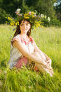 image photo : Girl in flowers wreath  on meadow
