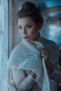 Girl in fluffy scarf portrait of beautiful near the window her shawl Royalty Free Stock Photos