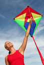Girl Flying a Kite Royalty Free Stock Photo