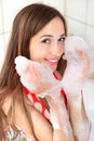 Girl with foam on hands Stock Photos