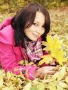 Girl on the foliage Royalty Free Stock Photo