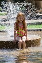 Girl in Fountain Stock Photo