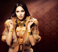 Girl in fox fur coat beauty fashion model Royalty Free Stock Image