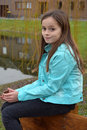 Girl with freckles cute teenager sitting outside at a little lake Royalty Free Stock Photo