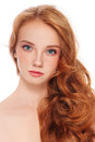Girl with freckles young beautiful long red hair and over white background Stock Image