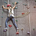 Girl in a free climbing wall Royalty Free Stock Photo