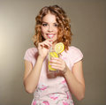Girl with fresh lemonade on gray background Stock Photo