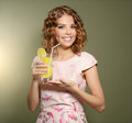Girl with fresh lemonade on light background Stock Images
