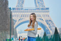 Girl with fresh tasty traditional french bread baguette near the eiffel tower beautiful young Royalty Free Stock Images