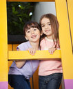 Girl with friend playing in playhouse portrait of little female Royalty Free Stock Photos