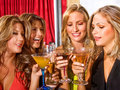 Girl friends in a bar Royalty Free Stock Photography