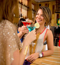 Girl friends having drinks beautiful at a bar Royalty Free Stock Image