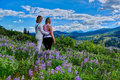Girl friends hiking in meadows full bloom. Royalty Free Stock Photo