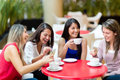 Girl friends meeting for coffee Royalty Free Stock Images