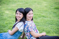 Girl friends smiling in park Royalty Free Stock Photo