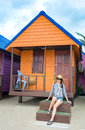 Girl in front of beach house Royalty Free Stock Photo