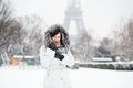Girl in front of the eiffel tower on a winter day beautiful woman Royalty Free Stock Image
