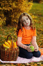Girl with fruit Stock Photography