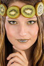 Girl with fruit make up in the form of kiwi Stock Photos