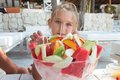 Girl with fruit salad Royalty Free Stock Images