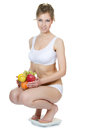 The girl with fruit and vegetables Stock Photography