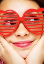 Girl with funny sunglasses Stock Images