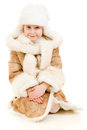 A girl in a fur coat and hat smiling Stock Photo