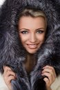 Girl in a fur coat on white background Royalty Free Stock Photos