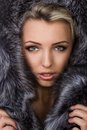 Girl in a fur coat on white background Royalty Free Stock Image