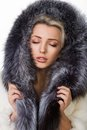 Girl in a fur coat on white background Royalty Free Stock Images