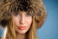 Girl with a fur hat. Royalty Free Stock Photography