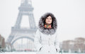 Girl in fur hood with the Eiffel tower in background Royalty Free Stock Image