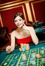 Girl gambles at the casino club Royalty Free Stock Photography