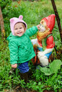 Girl-and-garden-gnome Stock Photography