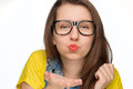 Girl in geek glasses blowing kiss isolated teenage on white background Stock Image
