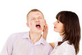 The girl gets angry pulls his guy for ear isolated on white background Stock Photos