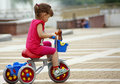 Girl gets on a bicycle Royalty Free Stock Image