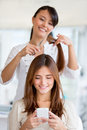 Girl getting a haircut at the beauty salon Stock Image